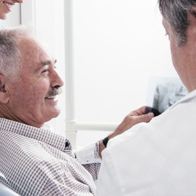 older man smiling at x-ray