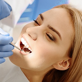 woman getting checked for gum disease