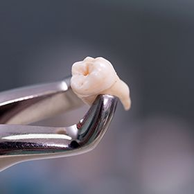 tooth on extraction tool