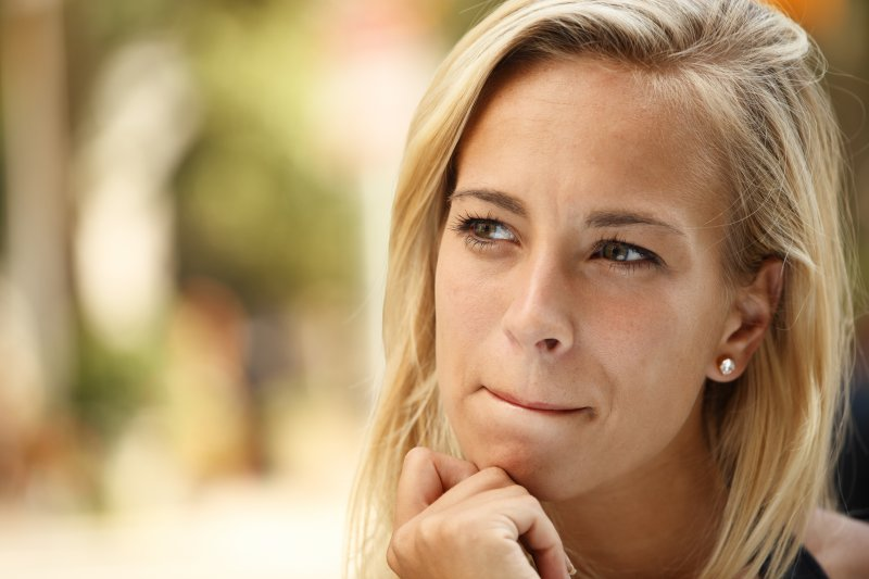 woman with blonde hair thinking