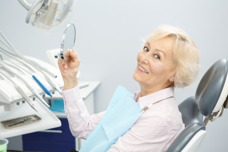 Mature woman with dental implants