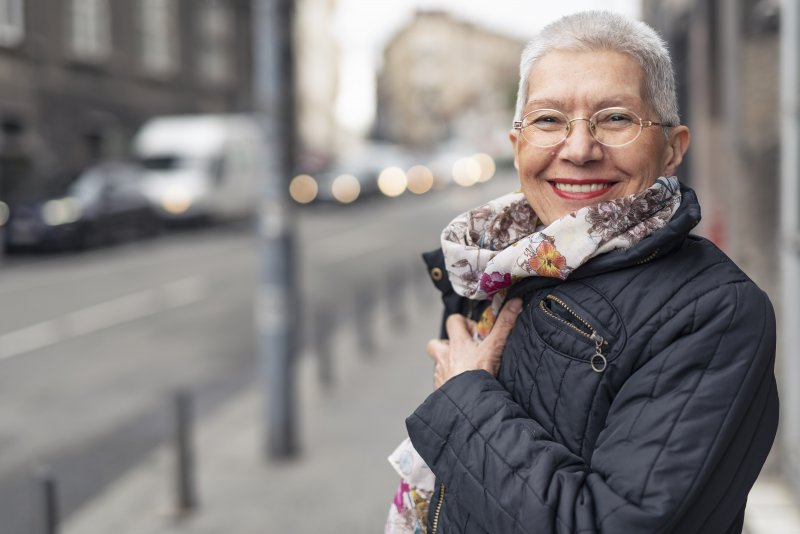 Woman smiling with dental implants in Lawrenceville