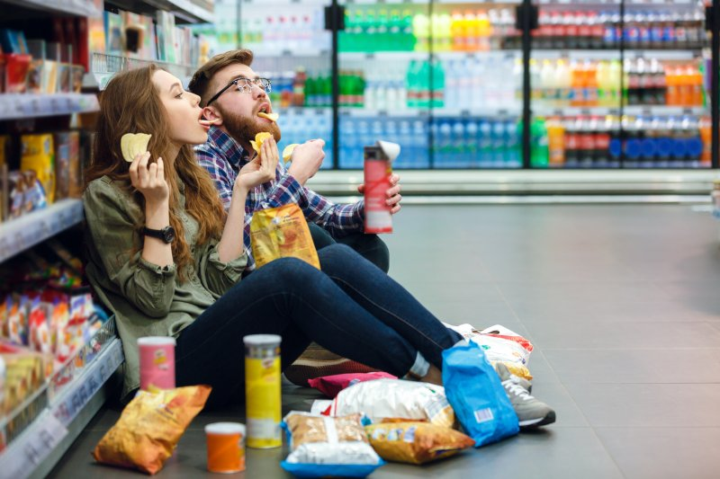 Couple snacking at grocery store
